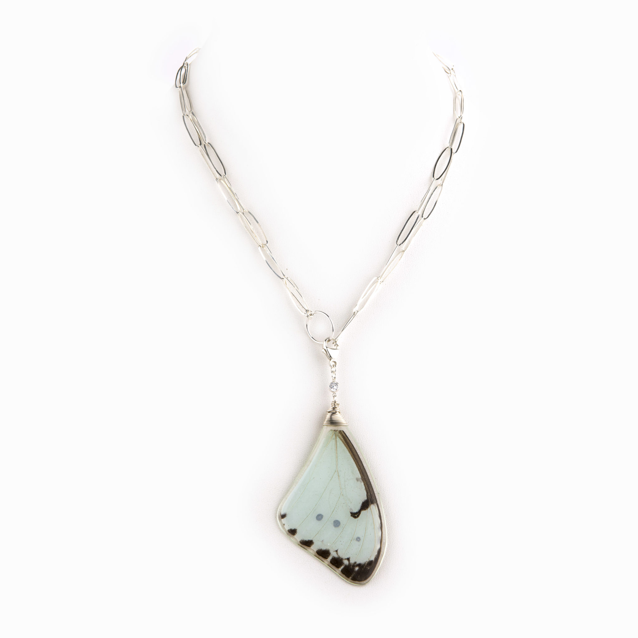 A delicate and thin sterling silver paper clip chain with light blue butterfly wing charm.