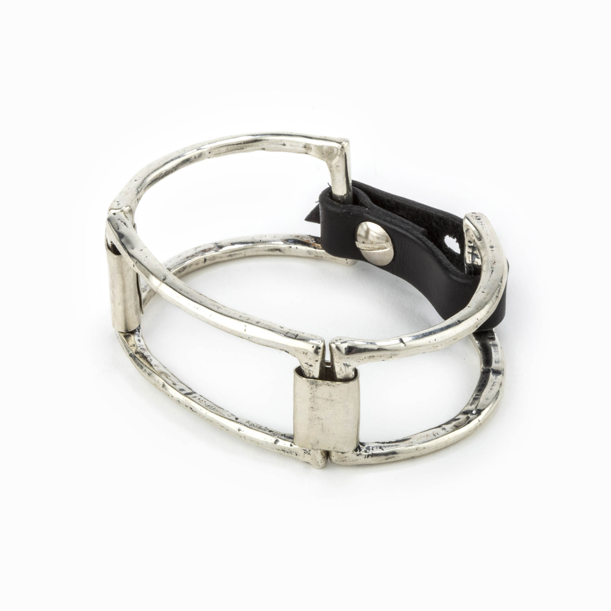A rhodium casted cuff with large square pieces linked together with sterling silver plates and an adjustable leather closure.