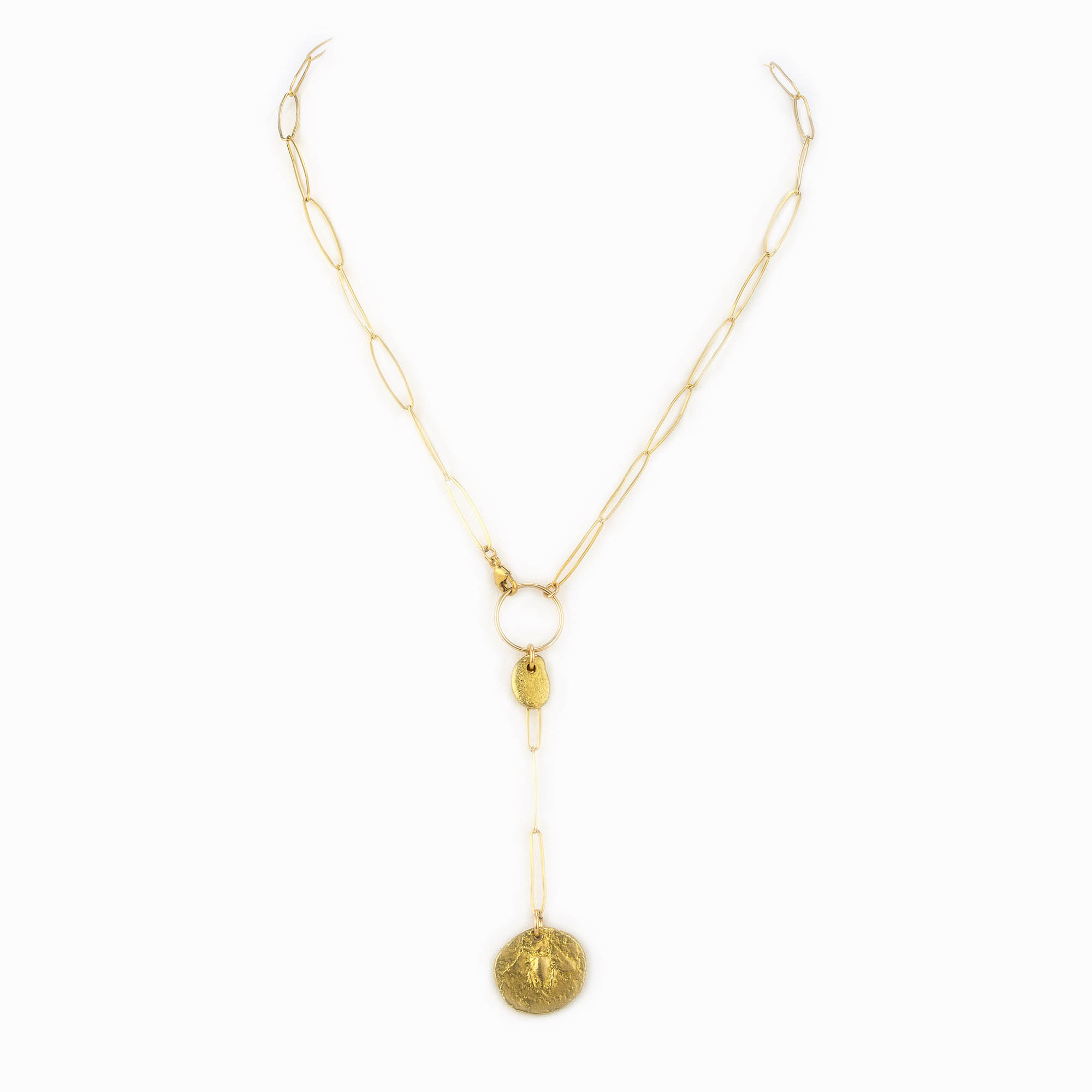 A 14k gold filled paperclip chain necklace with a small brass charm and a brass coin drop.