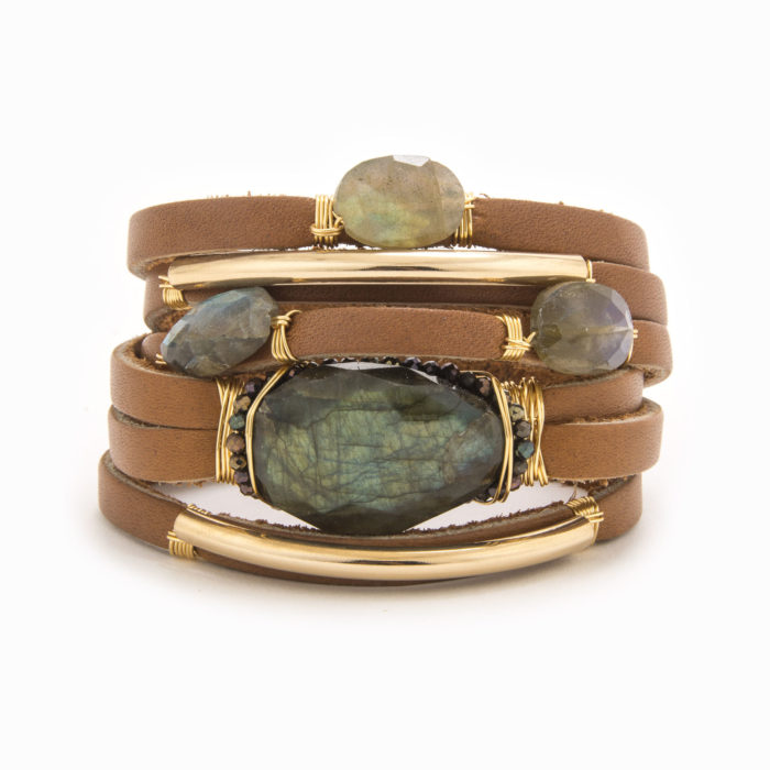 A smooth, tan-colored leather bracelet with wire wrapped in 14k gold fill tubes and labradorite stones.