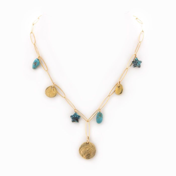 An adjustable 14k gold-filled paperclip chain necklace with brass coins and turquoise charms.