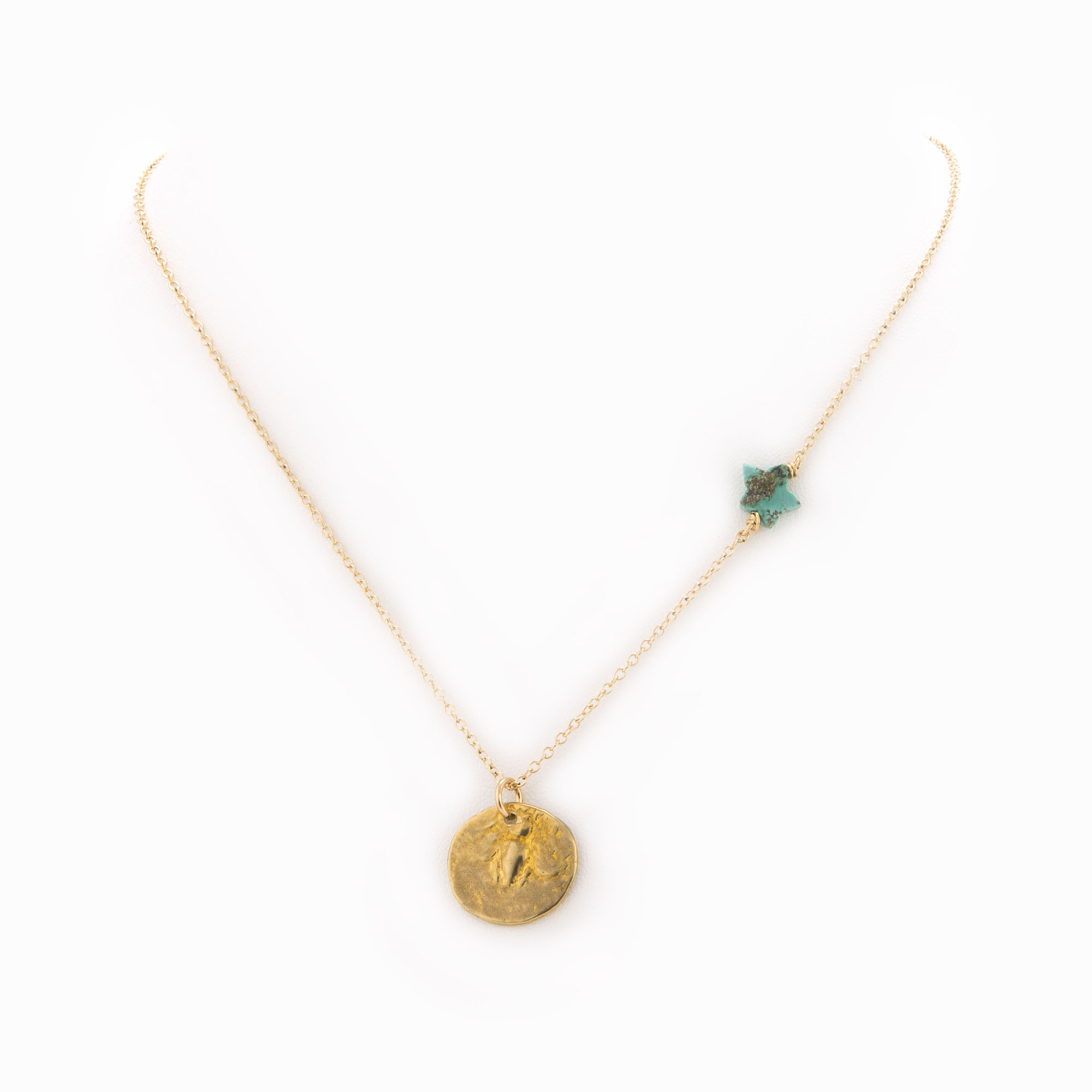 A 14k gold-filled chain necklace with brass coin and turquoise star charm.