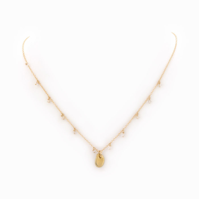 A 14k gold-filled chain necklace with a brass pebble and Herkimer quartz pieces.