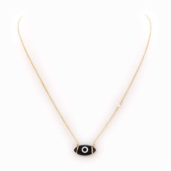 A delicate necklace with 14k gold fill chain and black onyx evil eye charm.