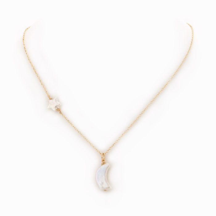 A delicate necklace with 14k gold-filled chain with a white pearl star and moon charm.