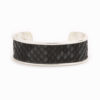 Front view of a medium silver cuff with charcoal colored snakeskin pattern inlaid.