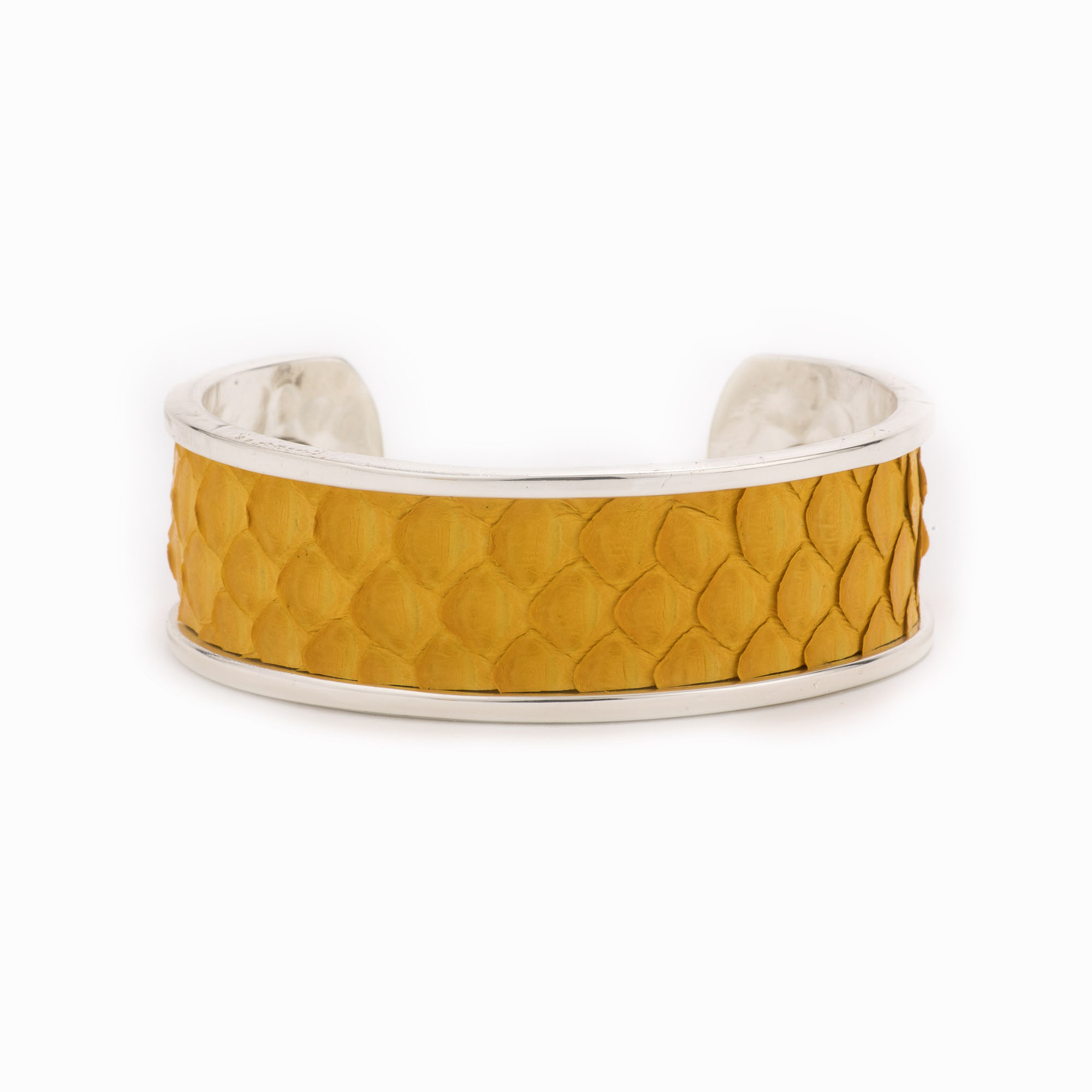 A medium silver cuff with mustard colored python skin pattern.