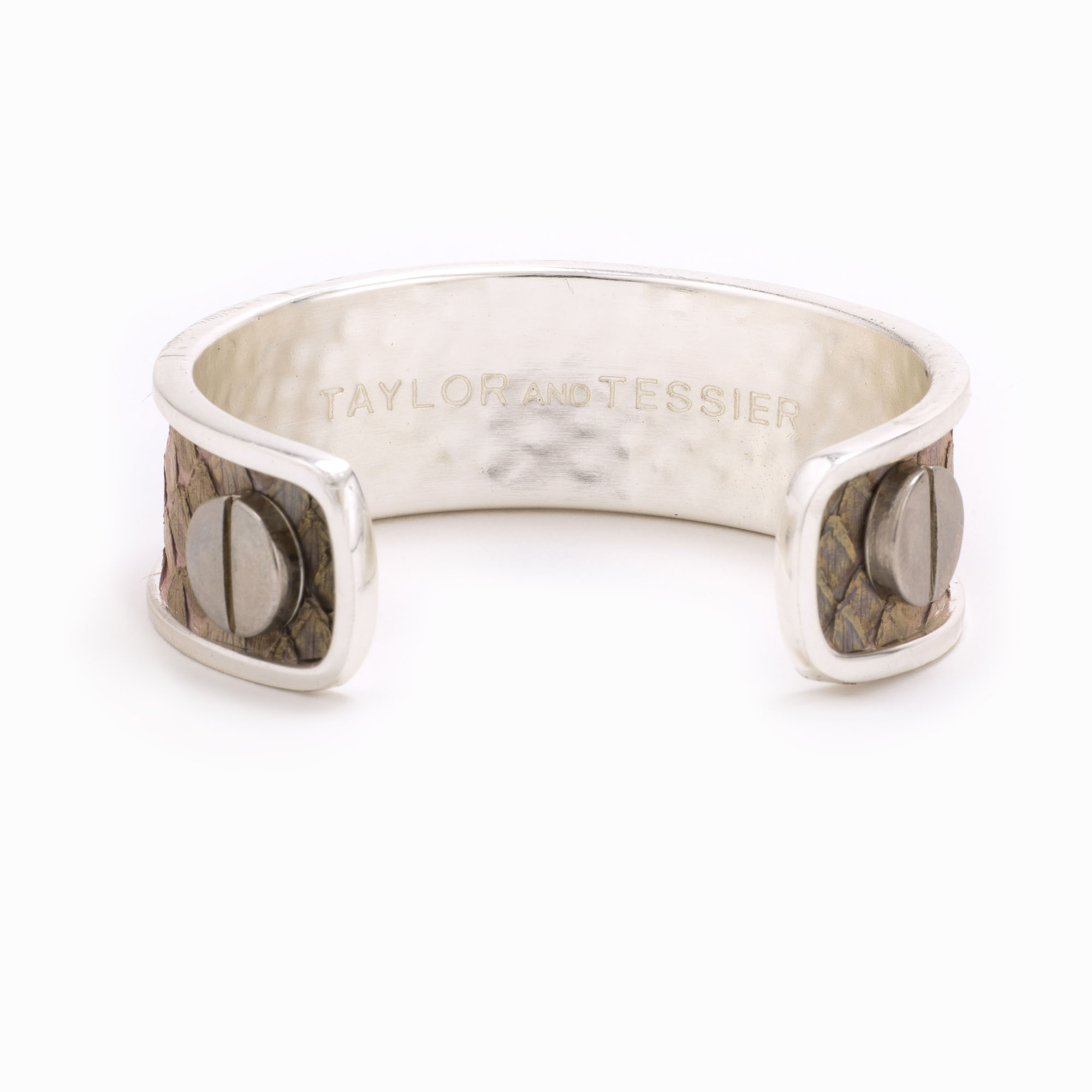 A medium silver cuff with white colored snakeskin pattern inlaid.