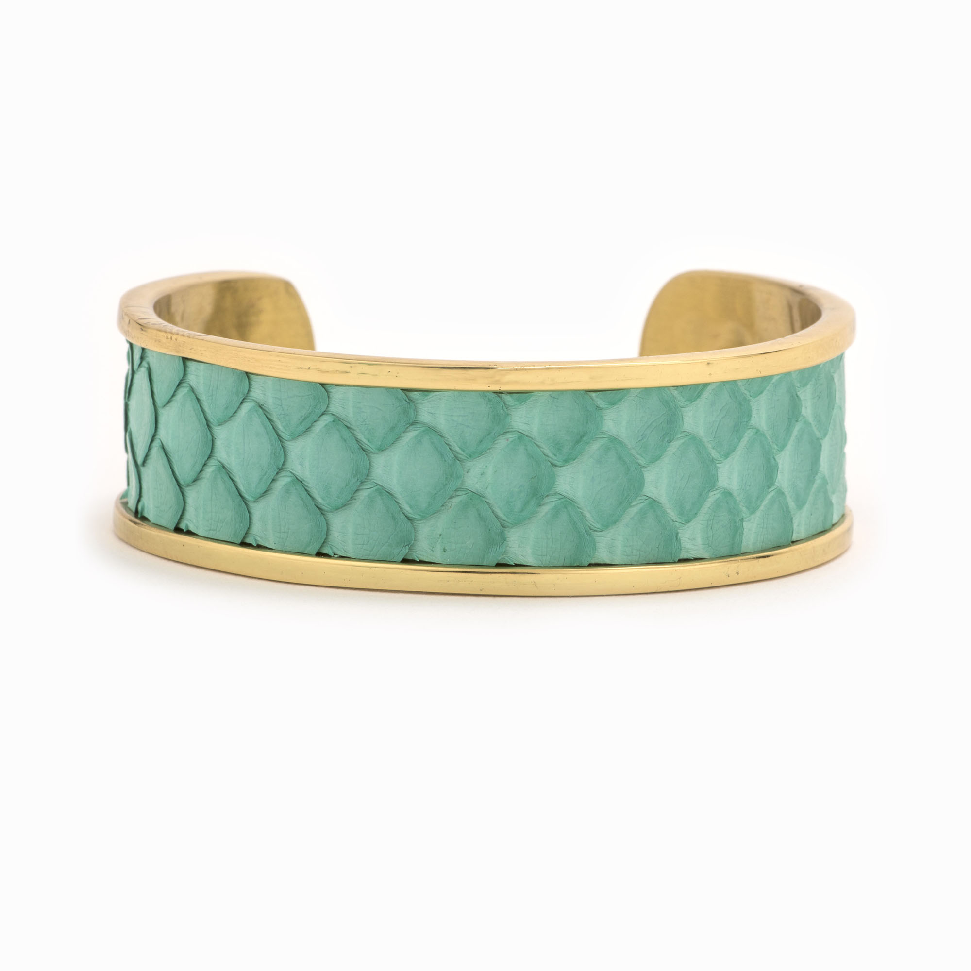 A medium gold cuff with turquoise colored snakeskin pattern inlaid.
