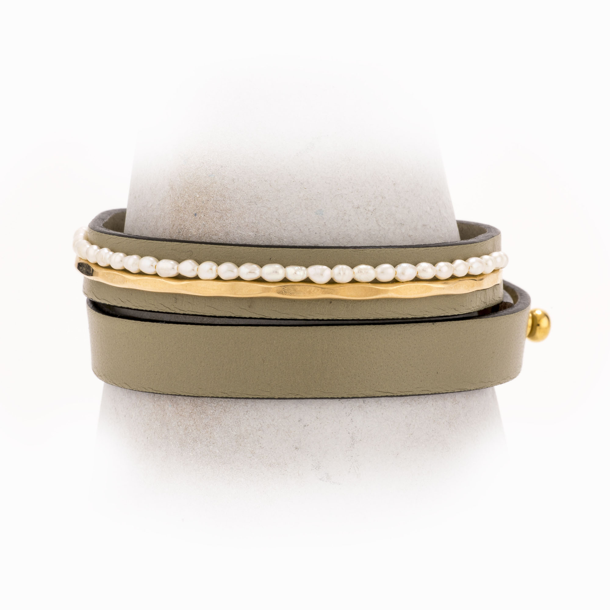 A taupe leather wrap bracelet with 14k gold-filled wire and mini pearls.