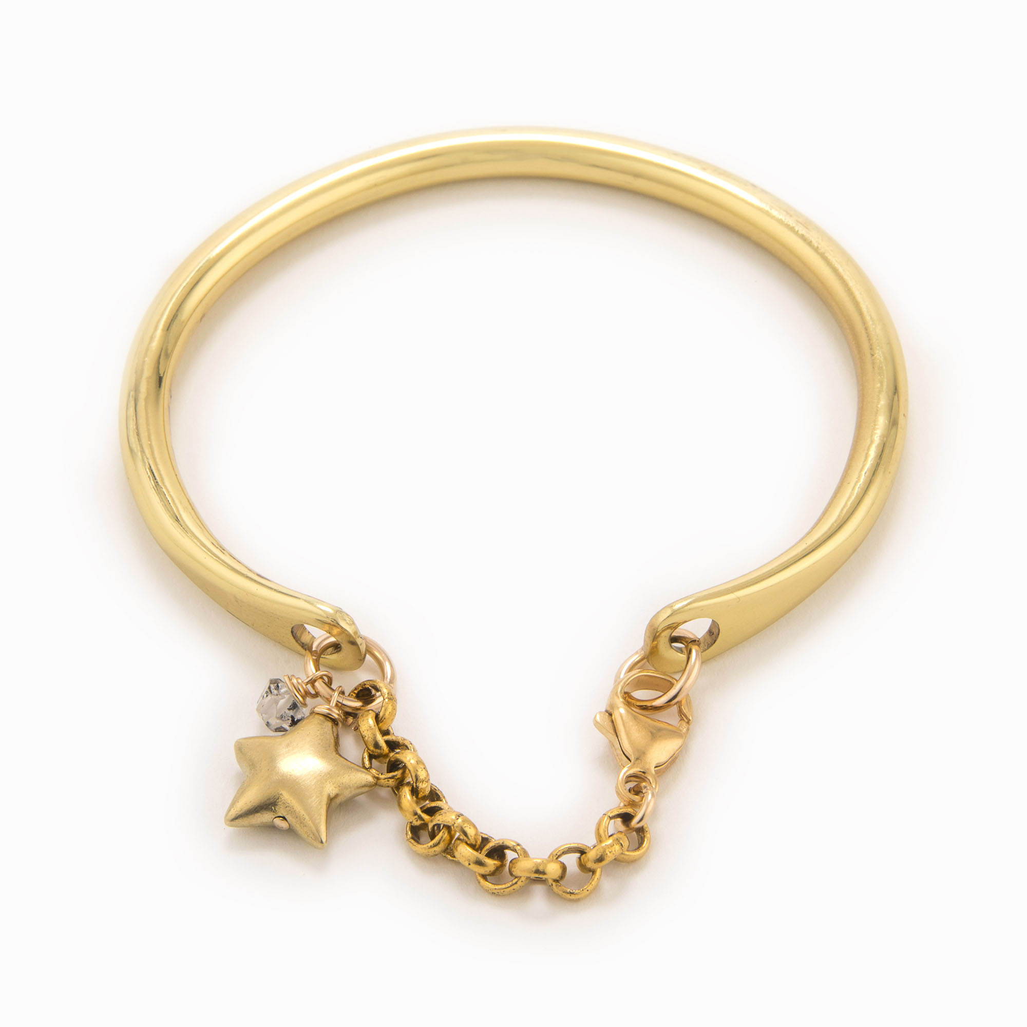 A brass cuff with rolo chain, Herkimer quartz and brass star charm.