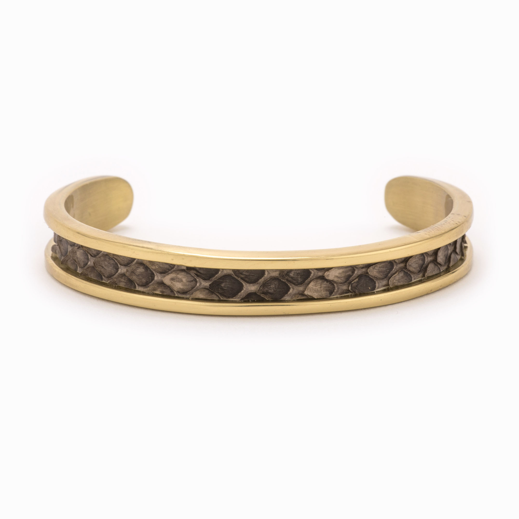 Small gold cuff and with a brown and grey snakeskin pattern.