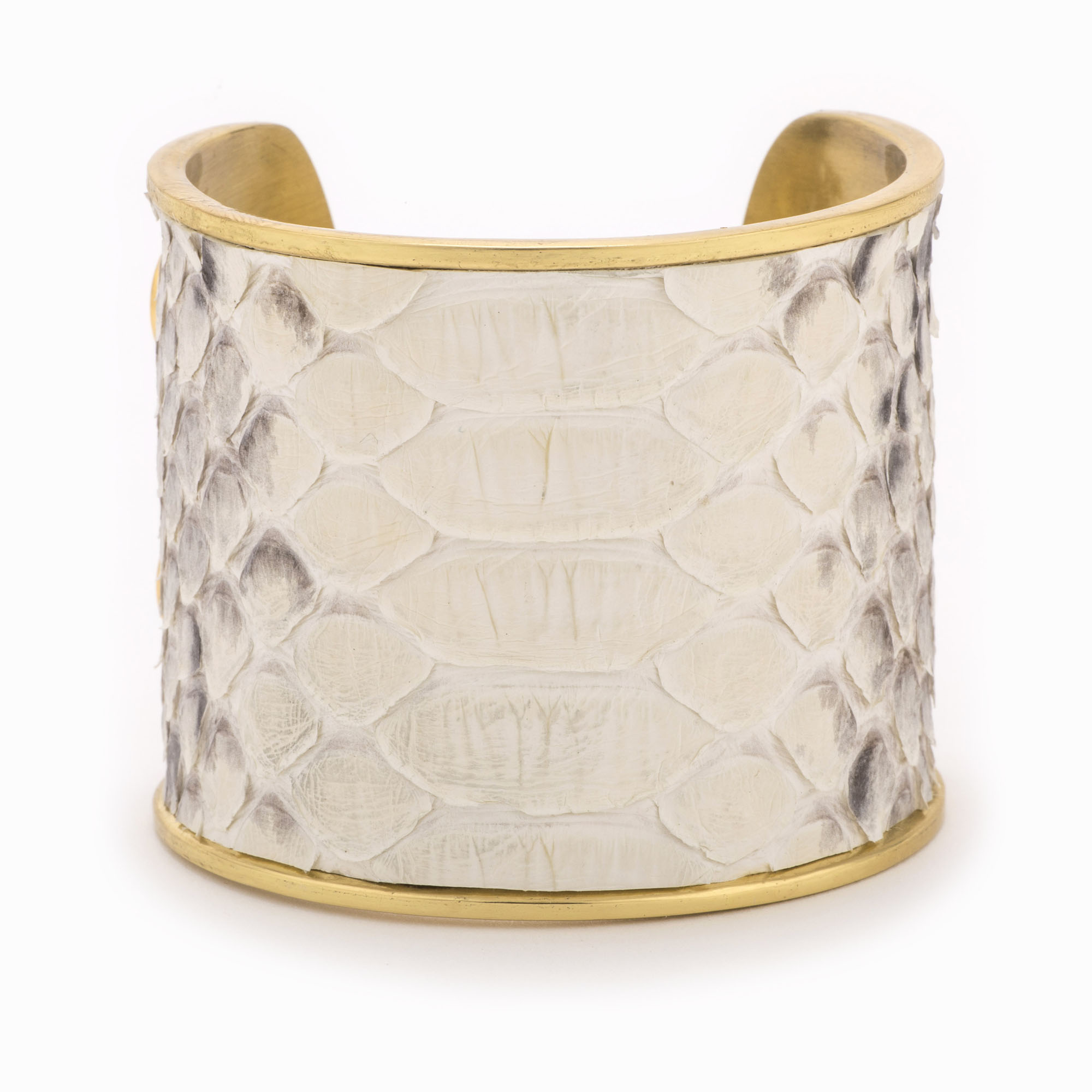 Large gold cuff with a black and white python pattern.